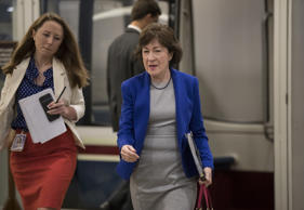 Sen. Susan Collins, R-Maine, speaks amid a crush of reporters after Republicans ...