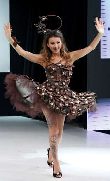 Slide 8 de 21: French broadcaster Marie-Ange Casalta presents a chocolate studded dress, during the chocolate dress fashion show as part of the 19th World Chocolate Fair in Paris on Oct. 29, 2013.