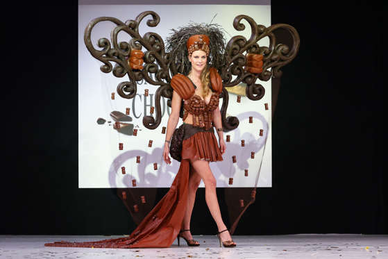 Slide 2 de 21: Cecile Belin walks the runway and wears a chocolate dress made by Marianne Galland and Cemoi during the Fashion Chocolate show at Salon du Chocolat at Parc des Expositions Porte de Versailles on October 28, 2014 in Paris, France.
