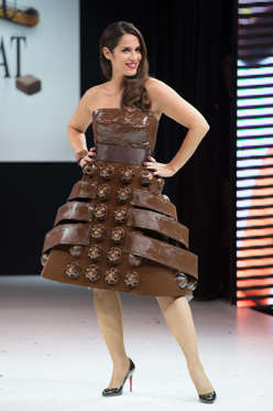 Slide 18 de 21: Singer and actress Elisa Tovati walks the runway and wears 'Gourmandise' a chocolate dress made by pastry maker Christelle Brua and Frederic Anton and designer Sonia Philippot during the Fashion Chocolate Show at Salon du Chocolat at Porte de Versailles, in Paris.