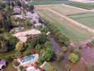 This June 25, 2017, photo taken by an unmanned aerial vehicle and released by the Tulare County Sheriff's Office shows flooding from the Kings River at the Kings River Golf and Country Club in Kingsburg, Calif. Authorities say 90 homes remain under mandatory evacuation orders following levee breaches along the Kings River in Central California.