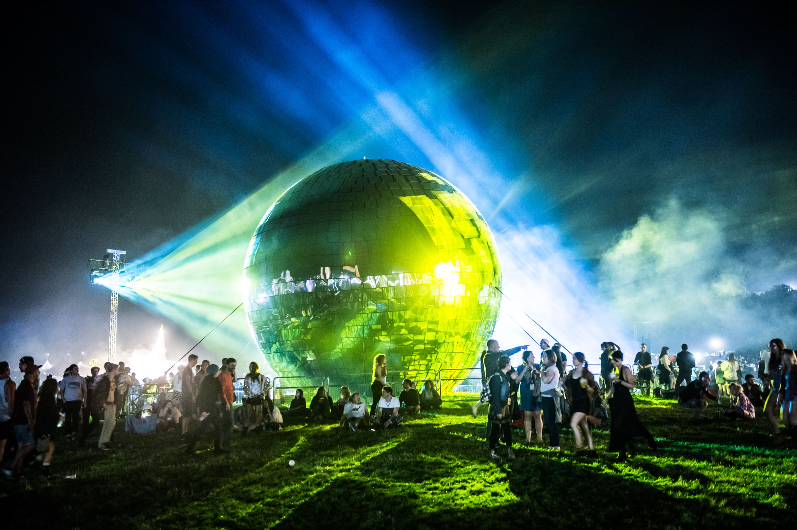 Slide 16 of 19: Festival goers enjoy the atmosphere around the official Guinness World Record holding Largest Disco Ball on the first nigh at the end of Day 1 of Bestival 2014 at Robin Hill Country Park on September 4, 2014 in Newport, Isle of Wight.