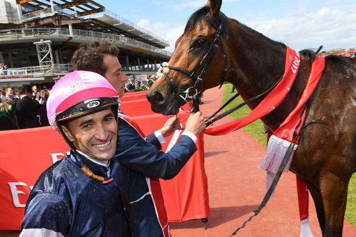 Corey Brown is all smiles after his Melbourne Cup win.