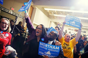 Supporters of Democratic gubernatorial candidate Ralph Northam begin to celebrate as results start to come in at Northam's election night rally on the campus of George Mason University in Fairfax, Virginia, November 7, 2017.