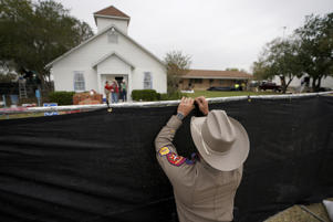 A Texas state trooper helps erect a fence around the site of the shooting at the First Baptist Church of Sutherland Springs, Texas, U.S. Nov. 9.