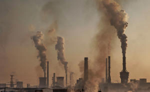 INNER MONGOLIA, CHINA - NOVEMBER 04: Smoke billows from a large steel plant as a Chinese labourer works at an unauthorized steel factory, foreground, on November 4, 2016 in Inner Mongolia, China. To meet China's targets to slash emissions of carbon dioxide, authorities are pushing to shut down privately owned steel, coal, and other high-polluting factories scattered across rural areas. In many cases, factory owners say they pay informal 'fines' to local inspectors and then re-open. The enforcement comes as the future of U.S. support for the 2015 Paris Agreement is in question, leaving China poised as an unlikely leader in the international effort against climate change. U.S. president-elect Donald Trump has sent mixed signals about whether he will withdraw the U.S. from commitments to curb greenhouse gases that, according to scientists, are causing the earth's temperature to rise. Trump once declared that the concept of global warming was 'created' by China in order to hurt U.S. manufacturing. China's leadership has stated that any change in U.S. climate policy will not affect its commitment to implement the climate action plan. While the world's biggest polluter, China is also a global leader in establishing renewable energy sources such as wind and solar power. (Photo by Kevin Frayer/Getty Images)