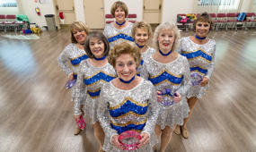 Pensioner cheerleaders high kicking into retirement