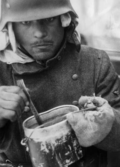 Slide 31 of 100: 2. World War: food supply - soldier eatingPhotograph: war correspondant Scheerer - 1943-