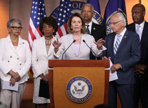 Democratic Leader Nancy Pelosi speaks while flanked by House members during a news conference on Capitol Hill on Friday. Pelosi called for the revocation of White House Adviser Jared Kushner's security clearance.