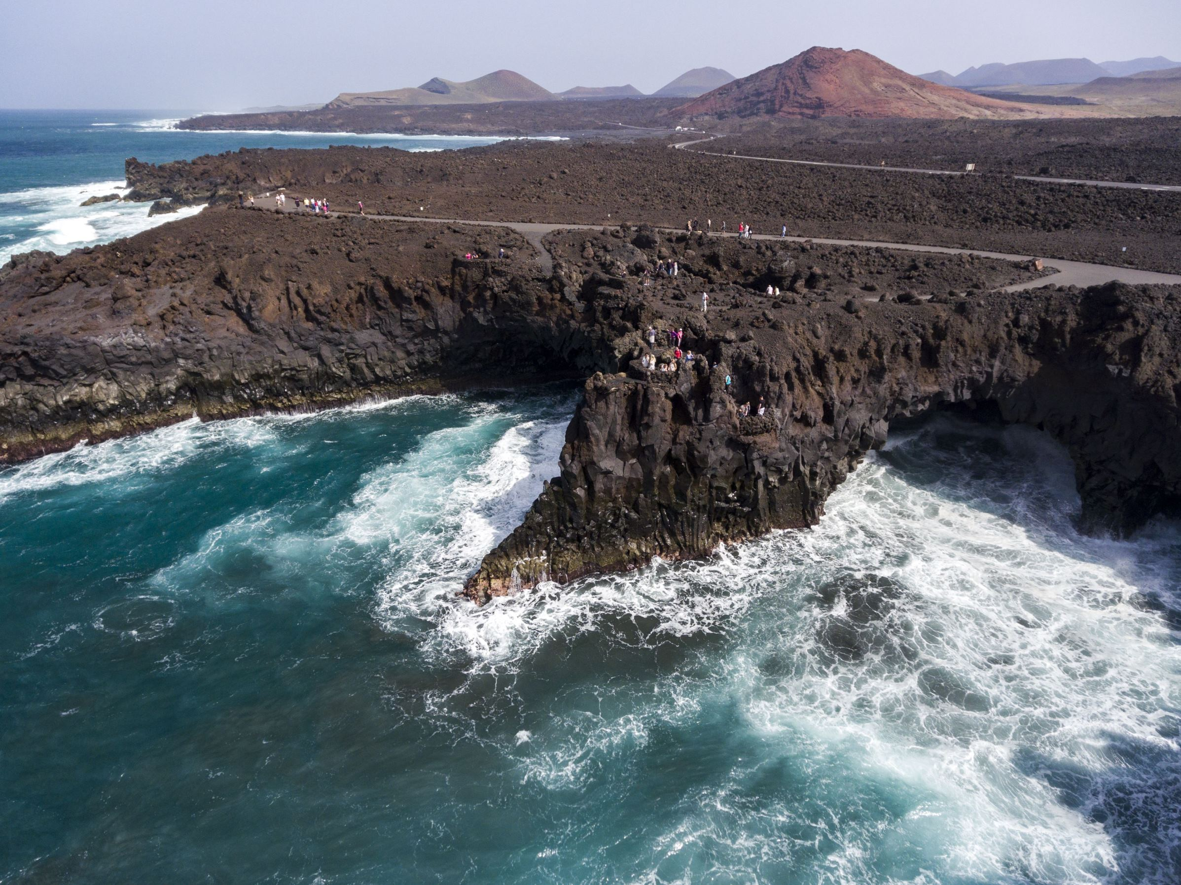 Slide 70 of 100: Much of Lanzarote has been shaped by devastating volcanic eruptions during the 18th century, leaving behind a lunar type landscape, black beaches and locations such as the Timanfaya National Park, which is home to an active volcano that gives the park its name