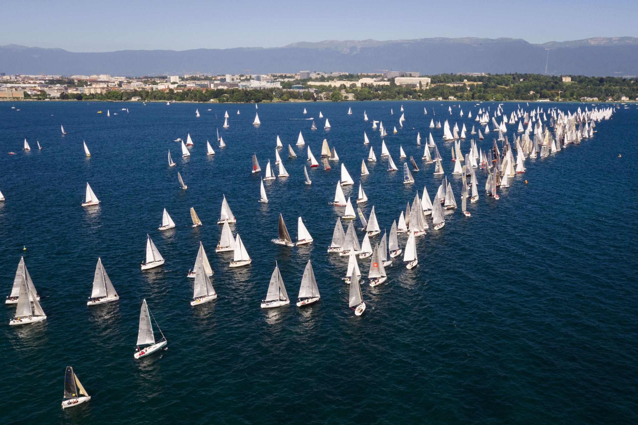 Slide 60 of 100: Photo taken with a drone shows sailboats line up on the starting line during the 79th Bol d'Or sailing race on Lake Geneva, in Geneva, Switzerland, 17 June 2017. About 550 boats participate in this weekend's Bol d'Or, the largest sailing race held on a lake in Europe.