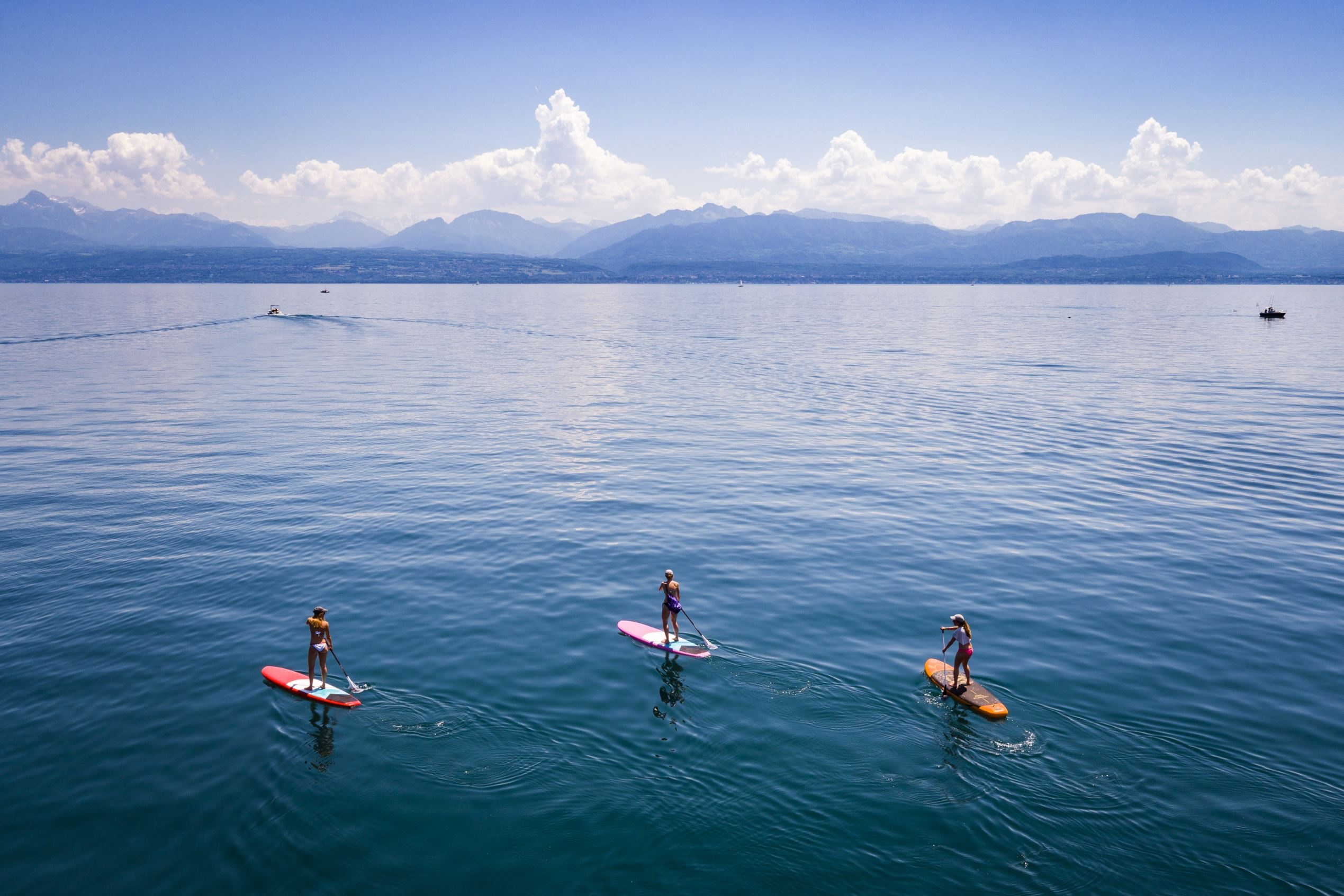 Slide 88 of 100: A photograph taken from a drone shows people on paddle boards as they enjoy the sunny and warm weather on Lake Geneva in Allaman, South western Switzerland, 27 May 2017.