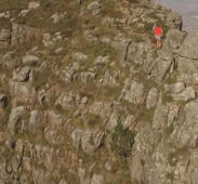 Athlete running across Table Mountain ridge