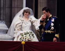 The Prince and Princess of Wales on the balcony of Buckingham Palace on their wedding day, 29th July 1981. She wears a wedding dress by David and Elizabeth Emmanuel and the Spencer family tiara. (Photo by Terry Fincher/Princess Diana Archive/Getty Images)
