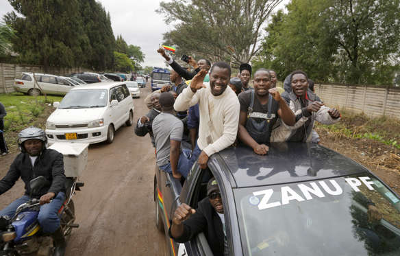 Slide 2 of 28: Protesters ride in a car with the name of the ruling party, calling for Mugabe to step down at a demonstration at Zimbabwe Grounds in Harare, Zimbabwe Saturday, Nov. 18, 2017.