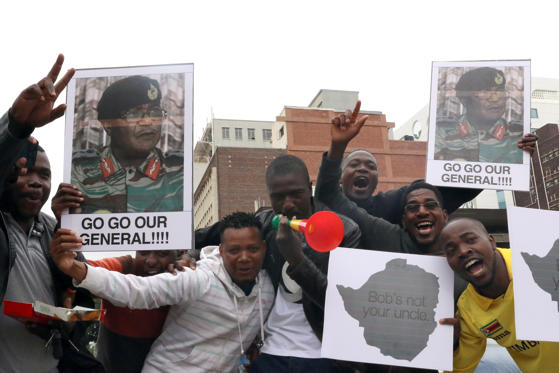 Slide 5 of 28: Protesters gather calling for Zimbabwe President Robert Mugabe to step down, in Harare, Zimbabwe November 18, 2017.