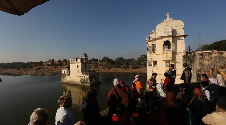 Tourists watching the Rani Padmavati Mahal and Jal Mahal in the Chittorgarh Fort in Rajasthan, well known for the beauty of Rani Padmavati and the attack by Allauddin Khilji in the 14th century.