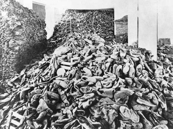 Slide 20 of 100: CAPTION: (Eingeschränkte Rechte für bestimmte redaktionelle Kunden in Deutschland. Limited rights for specific editorial clients in Germany.) Germany. Third Reich. NS era. Persecution of Jews. Holocaust. Probably Concentration Camp of Treblinka or Belzec. Piled up shoes of murdered prisoners (location not verified, presumably Treblinka, (Photo by ullstein bild/ullstein bild via Getty Images)