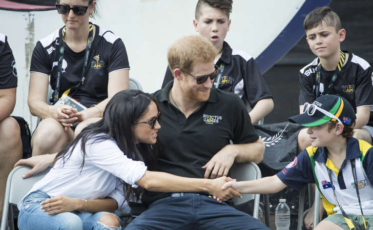 Prince Harry and Meghan Markle watch Wheelchair Tennis at the 2017 Invictus Games in Toronto, Canada.
