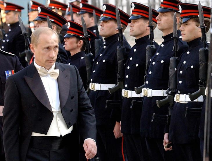 File photo: Putin inspects an honour guard drawn from the Honourable Artillery Company at the Guildhall in London
