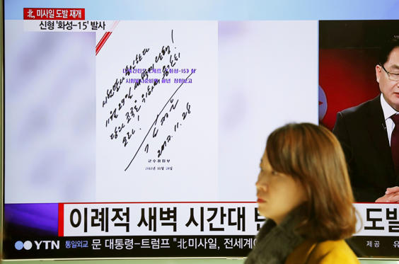 """Slide 2 of 79: People watch a TV broadcasting a news report on North Korea firing what appeared to be an intercontinental ballistic missile (ICBM) that landed close to Japan, in Seoul, South Korea, November 29, 2017. In this handwritten order visible on a screen, dated November 28 by Kim Jong Un, he says: """"I order a test launch. Carry out on Nov 29 at dawn. Fire it bravely for the Party and the motherland!"""" REUTERS/Kim Hong-Ji"""