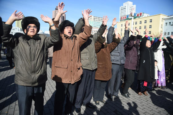 Slide 4 of 79: Pyongyang residents react at the Pyongyang Railway Station after the news of the successful launch of the new intercontinental ballistic missile (ICBM) Hwasong-15 in Pyongyang on November 29, 2017.  North Korean leader Kim Jong Un said on November 29 his country had achieved full nuclear statehood after successfully testing a new missile capable of hitting anywhere in the United States. / AFP PHOTO / Kim Won-Jin        (Photo credit should read KIM WON-JIN/AFP/Getty Images)