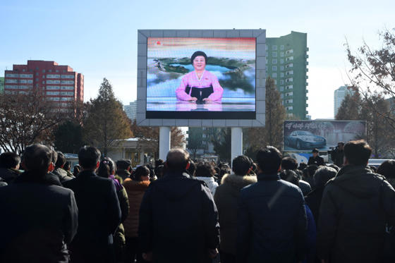 Slide 3 of 79: Pyongyang residents watch a big screen near the Pyongyang Railway Station showing the news on the successful launch of the new intercontinental ballistic missile (ICBM) Hwasong-15 in Pyongyang on November 29, 2017.  North Korean leader Kim Jong Un said on November 29 his country had achieved full nuclear statehood after successfully testing a new missile capable of hitting anywhere in the United States. / AFP PHOTO / Kim Won-Jin        (Photo credit should read KIM WON-JIN/AFP/Getty Images)