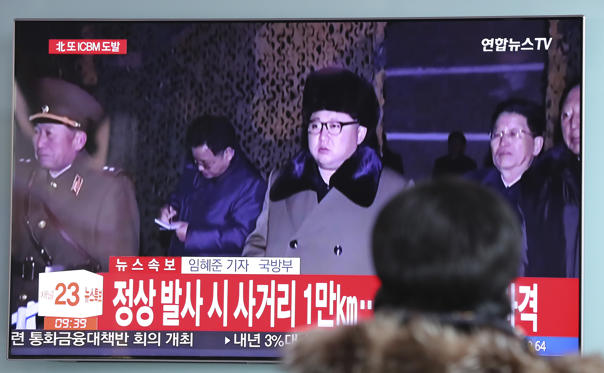 """Slide 5 of 79: A woman watches a TV screen showing a local news program reporting about North Korea's missile launch with a file footage of North Korean leader Kim Jong Un, at the Seoul Railway Station in Seoul, South Korea, Wednesday, Nov. 29, 2017. After 2 ½ months of relative peace, North Korea launched its most powerful weapon yet early Wednesday, a presumed intercontinental ballistic missile that could put Washington and the entire eastern U.S. seaboard within range. The letters read """"North Korea, Provocation with ICBM."""" (AP Photo/Lee Jin-man)"""