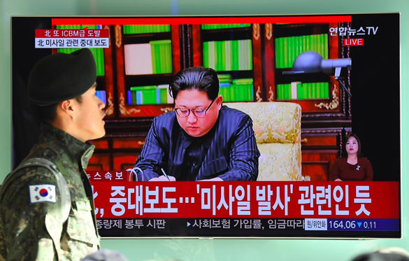 """Slide 1 of 79: A South Korean soldier walks past a television news screen showing North Korean leader Kim Jong-Un approving the country's new ICBM test, at a railway station in Seoul on November 29, 2017 Nuclear-armed North Korea said on November 29 it had successfully tested a new intercontinental ballistic missile that put """"all of the US continent"""" within its range.  / AFP PHOTO / JUNG Yeon-Je        (Photo credit should read JUNG YEON-JE/AFP/Getty Images)"""