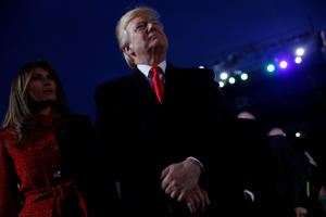 President Donald Trump and first lady Melania Trump participate in the National Christmas Tree lighting ceremony near the White House in Washington, U.S. November 30, 2017.