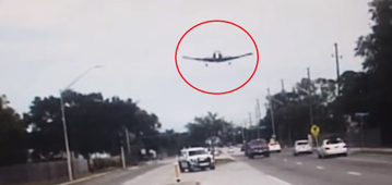 Police dash cam captures plane crash on motorway