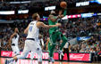 DALLAS, TX - NOVEMBER 20:  Kyrie Irving #11 of the Boston Celtics drives to the basket against Dirk Nowitzki #41 of the Dallas Mavericks at American Airlines Center on November 20, 2017 in Dallas, Texas.