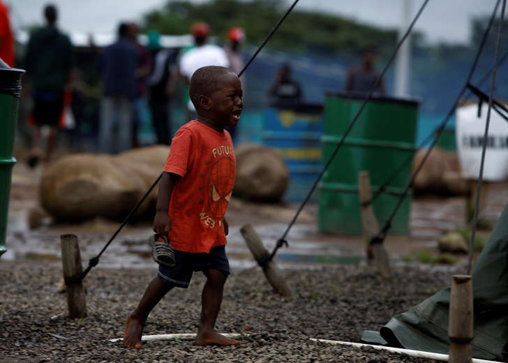 A Haitian migrant boy cries as he walks at a makeshift camp at the border between Costa Rica and Nicaragua, in La Cruz, Costa Rica, December 20, 2016.