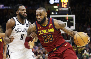 Cleveland Cavaliers' LeBron James (23) drives against Brooklyn Nets' DeMarre Carroll (9) during the second half of an NBA basketball game, Wednesday, Nov. 22, 2017, in Cleveland. The Cavaliers won 119-109. (AP Photo/Tony Dejak)
