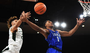 PORTLAND, OR - NOVEMBER 23: Trevon Duval #1 of the Duke Blue Devils is fouled by Holland Woods #23 of the Portland State Vikings as the drives to the basket during the second half of the game at the Veterans Memorial Coliseum on November 23, 2017 in Portland, Oregon.  (Photo by Steve Dykes/Getty Images)