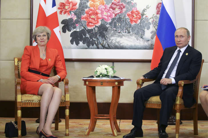 Russia's President Vladimir Putin (R) and British Prime Minister Theresa May pictured during a meeting