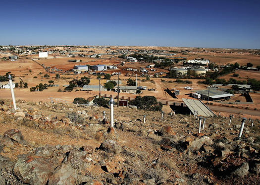 Slide 1 of 26: COOBER PEDY, AUSTRALIA - JUNE 12: General view of the outback mining town of Coober Pedy, June 12, 2005, Australia. Australia supplies 95 percent of the world's opal supply, with most coming from Coober Pedy. Opal is a precious stone comprised of amorphous silica and water, with the more valuable stones displaying vivid colours. (Photo by Ian Waldie/Getty Images)