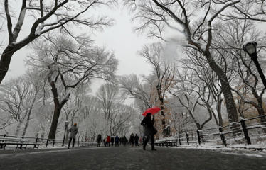 NEW YORK, NY - DECEMBER 9: People walk through Central Park during a snowstorm on December 9, 2017 in New York City. (Photo by Gary Hershorn/Getty Images)