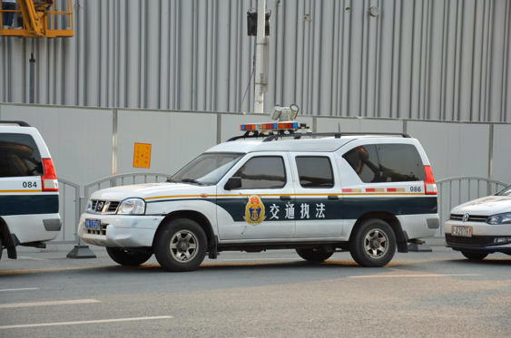 Slide 11 of 78: <p>Developed in China, the Nissan Rui Qi is an extended and raised SUV based on the first-generation Navara pickup truck. Its ungainly proportions give it an unusually large cabin, which makes it ideal for police duty. Some examples wear a Nissan emblem, like the one pictured here, while later models built by the Zhengzhou-Nissan joint-venture receive a look of their own with a brand-specific grille. Zhengzhou-Nissan continues to make the Rui Qi for various government services, including the Chinese postal service, and it even offers the model as an electric vehicle.</p>