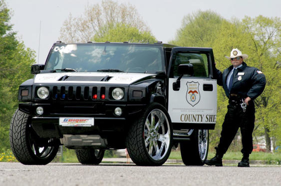 Slide 33 of 78: <p>A Texan sheriff didn't want to have to drive a regular Hummer H2; he wanted something a whole lot meaner. So he commissioned German tuning company Geiger to uprate things by supercharging the 7.0-litre V8 to produce 700bhp and 667lb ft of torque – and to fit 28-inch wheels to make sure the car was as uncomfortable as it was fast.</p>