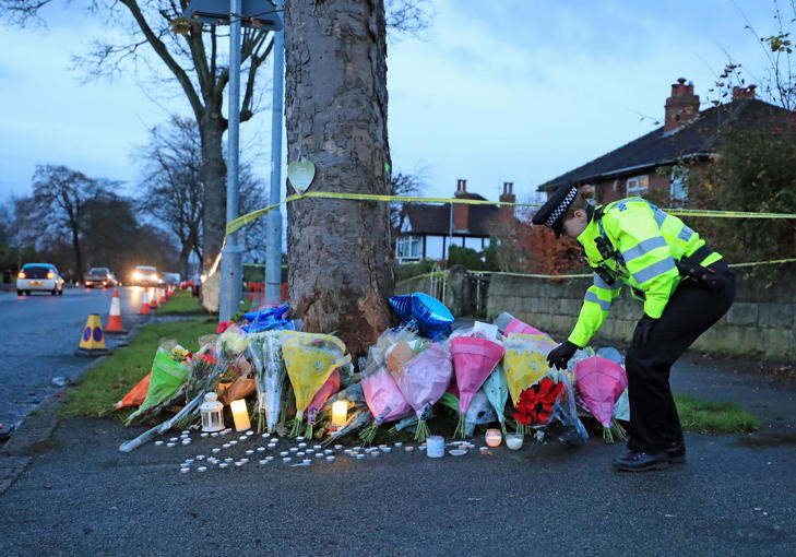 Floral tributes are left near the scene of a car crash in Stonegate Road, Leeds, that claimed the lives of five people, including three children.