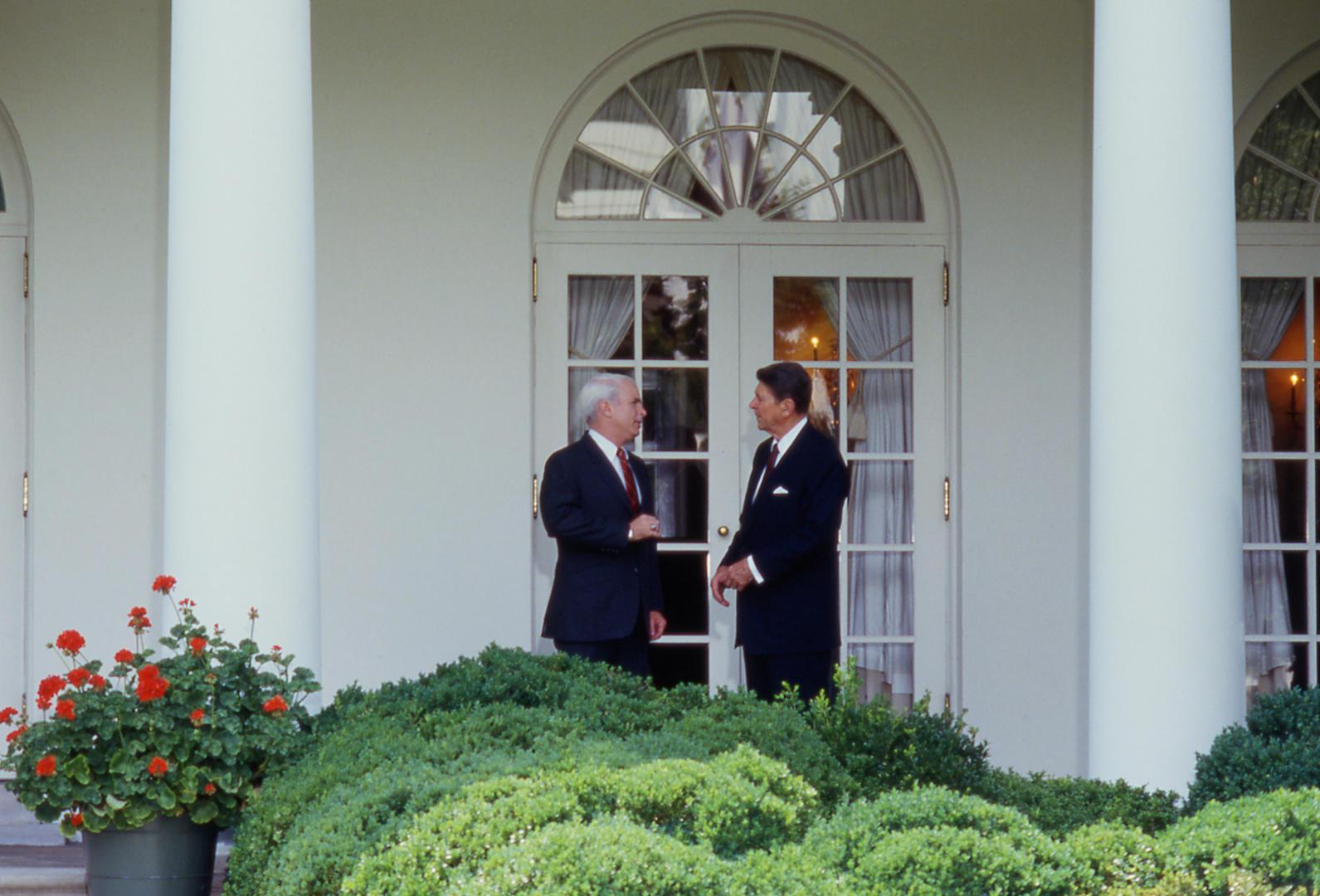 Slide 8 of 18: John McCain and Ronald Reagan in 1987.