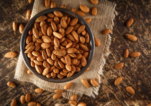 Raw Organic Almonds Photographed on a Piece of Burlap