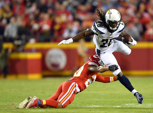 Slide 1 of 78: Running back Melvin Gordon #28 of the Los Angeles Chargers carries the ball as cornerback Steven Nelson #20 of the Kansas City Chiefs defends during the game at Arrowhead Stadium on December 16, 2017 in Kansas City, Missouri.
