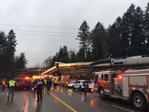 Slide 8 of 15: Photo by WASHINGTON STATE PATROL/HANDOUT HANDOUT/EPA-EFE/REX/Shutterstock (9296648c) A handout photo made available by the Washington State Patrol (WSP) showing  Amtrak train 501 which derailed onto Interstate 5 near Olympia, Washington, USA, 18 December 2018. Reports state that the Amtrak train car fell from an overpass, landing on the highway outside Seattle. Currently there is no information on casualties. Amtrak train derails over highway, Olympia, USA - 18 Dec 2017