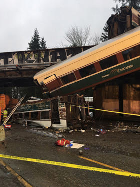 Slide 14 of 15: A handout photo made available by the Washington State Patrol (WSP) showing Amtrak train 501 which derailed onto Interstate 5 near Olympia, Washington, USA, 18 December 2018. Reports state that the Amtrak train car fell from an overpass, landing on the highway outside Seattle. Currently there is no information on casualties.