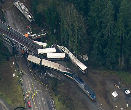 "Slide 1 of 15: This aerial image from video provided by KOMO-TV, shows the site of an Amtrak train that derailed south of Seattle on Monday, Dec. 18, 2017. Authorities reported ""injuries and casualties."" The train derailed about 40 miles (64 kilometers) south of Seattle before 8 a.m., spilling at least one train car on to busy Interstate 5. (KOMO-TV via AP) TV OUT MANDATORY CREDIT"