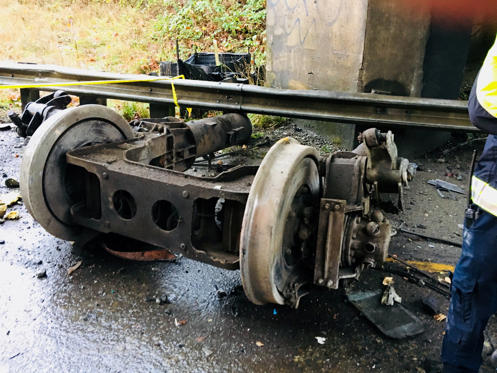 Slide 2 of 15: Parts of an Amtrak passenger train at the scene of derailment on interstate highway (I-5) is seen in this Pierce County Sheriff's Department image moved on social media in DuPont, Washington, U.S., December 18, 2017.   Courtesy Pierce County Sheriff's Department/Handout via  REUTERS    ATTENTION EDITORS - THIS IMAGE HAS BEEN SUPPLIED BY A THIRD PARTY. - RC184EEE33D0