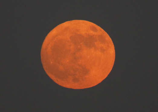 Slide 2 of 23: An orange-colored so-called 'Supermoon' is rising over the Tokyo Bay, in Tokyo, Japan, 03 December 2017. According to the National Aeronautics and Space Administration (NASA) a series of three 'Supermoons' - dubbed the 'Supermoon trilogy' - will appear in the sky on 03 December 2017, on 01 January 2018 and and 31 January 2018. A 'Supermoon' commonly is a full moon at its closest distance to the earth with the moon appearing larger than usual. Supermoon rises over the Tokyo Bay, Japan - 03 Dec 2017