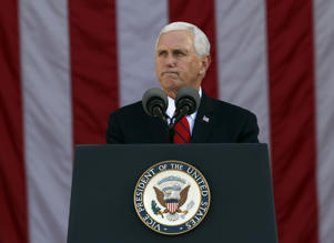 Vice President Mike Pence pauses while speaking during a Veterans Day ceremony at Arlington National Cemetery, Saturday, Nov. 11, 2017 in Washington.